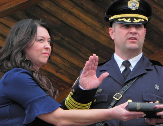Sheri Jarvis (left) stands near her husband Richard Jarvis Sr. as he takes the oath to become the newest Chief of the Lyndhurst Police Department on Monday, April 8, 2019.