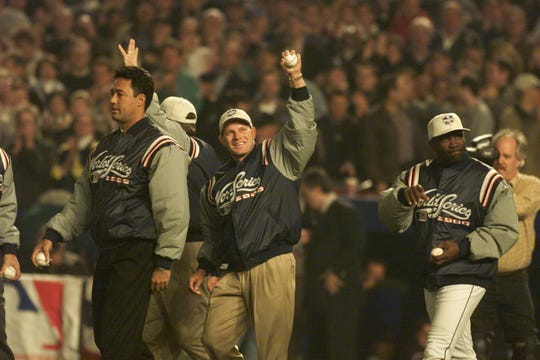 The 1986 champion New York Mets throw out the first pitch before Game 5 of the 2000 World Series against the New York Yankees. From left, Lenny Dykstra, Ron Darling and Mookie Wilson.