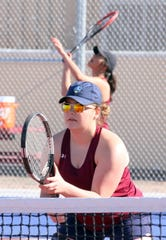 Senior Lady 'Cat Taylor Benavidez is prepped at the net during Deming doubles.