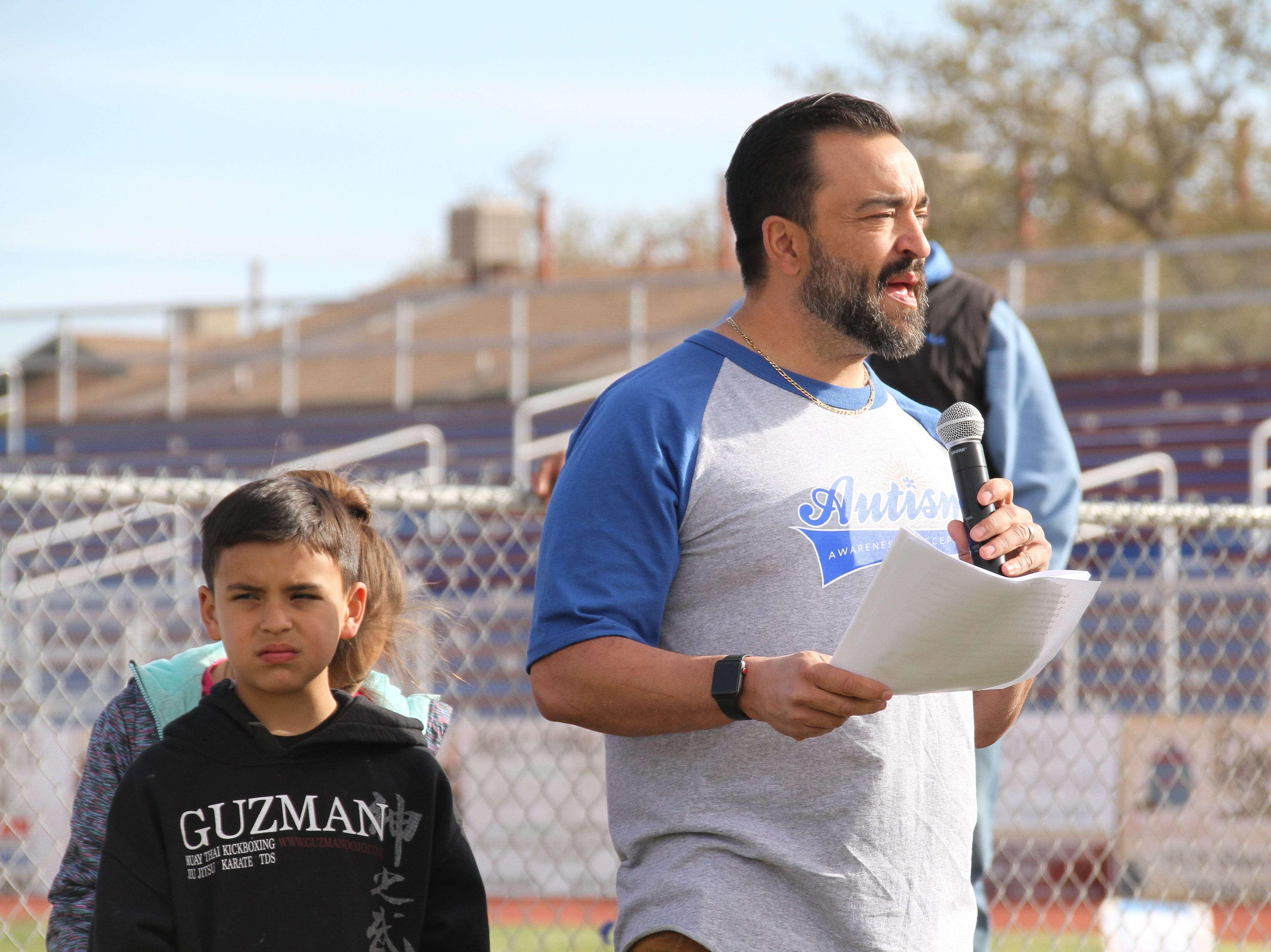 Deming Public Schools Superintendent Dr. Arsenio Romero, whose daughter has autism was invited to be this year's Deming Autism Walk speaker. At Romero's left is his 8-year-old son Andru and behind him is 9-year-old Adilen.