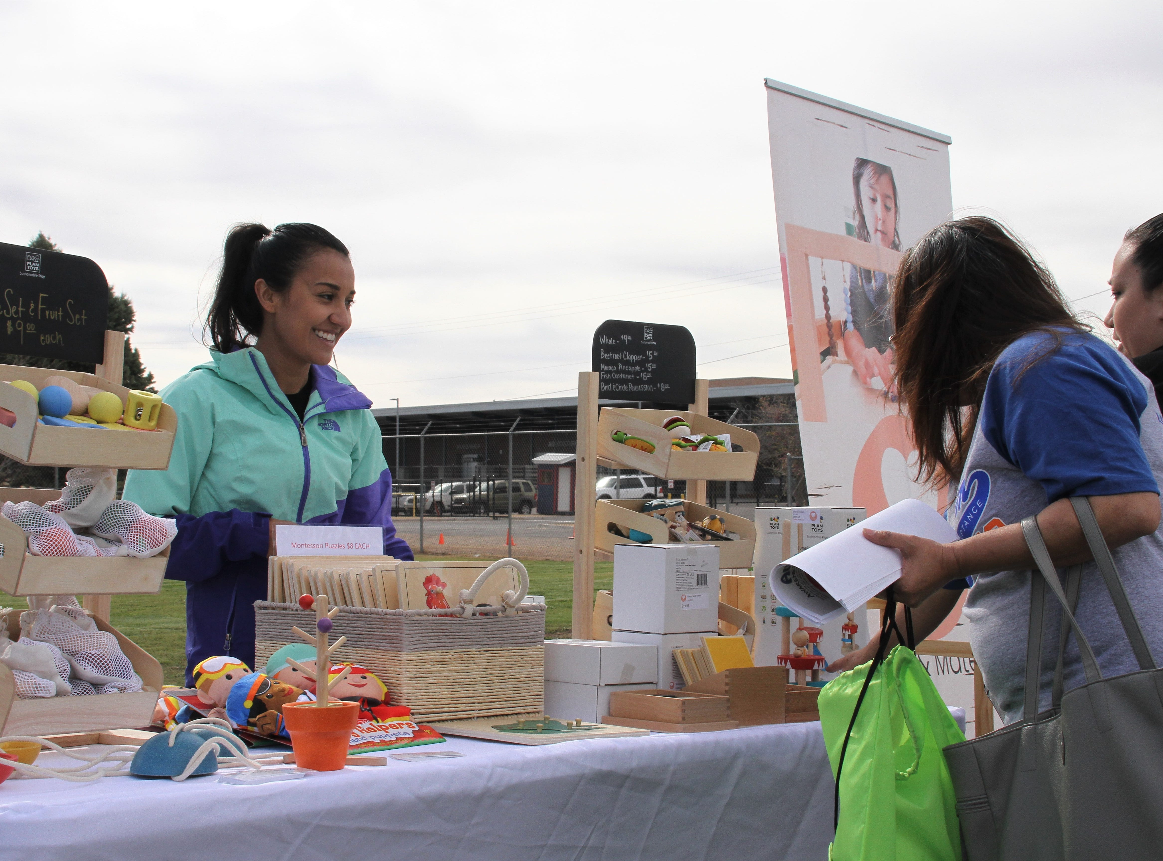 Kalyn Blazak, hosting a booth for Play Sharity, a new and rising children's museum in Deming.