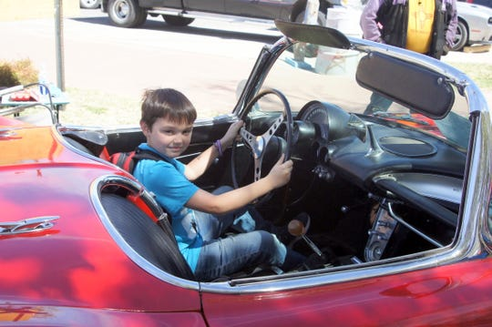 Hugh Epping of Silver City, NM allowed guests to sit in his 1962 convertible Corvette.