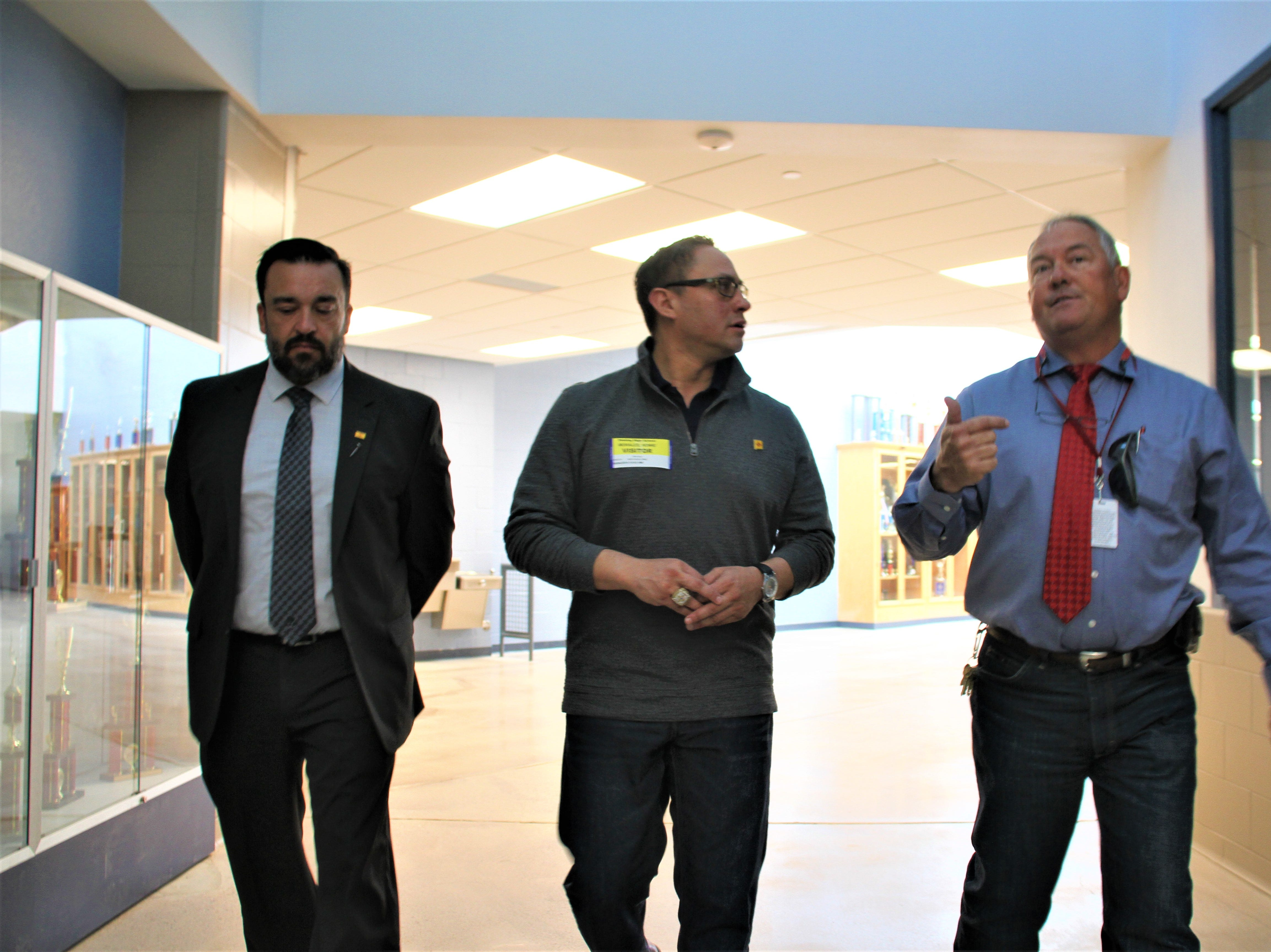 From left, Superintendent Dr. Arsenio Romero, Lt. Gov. Howie Morales and Chief of Support Services Herb Borden patrolling the halls of Deming High School.