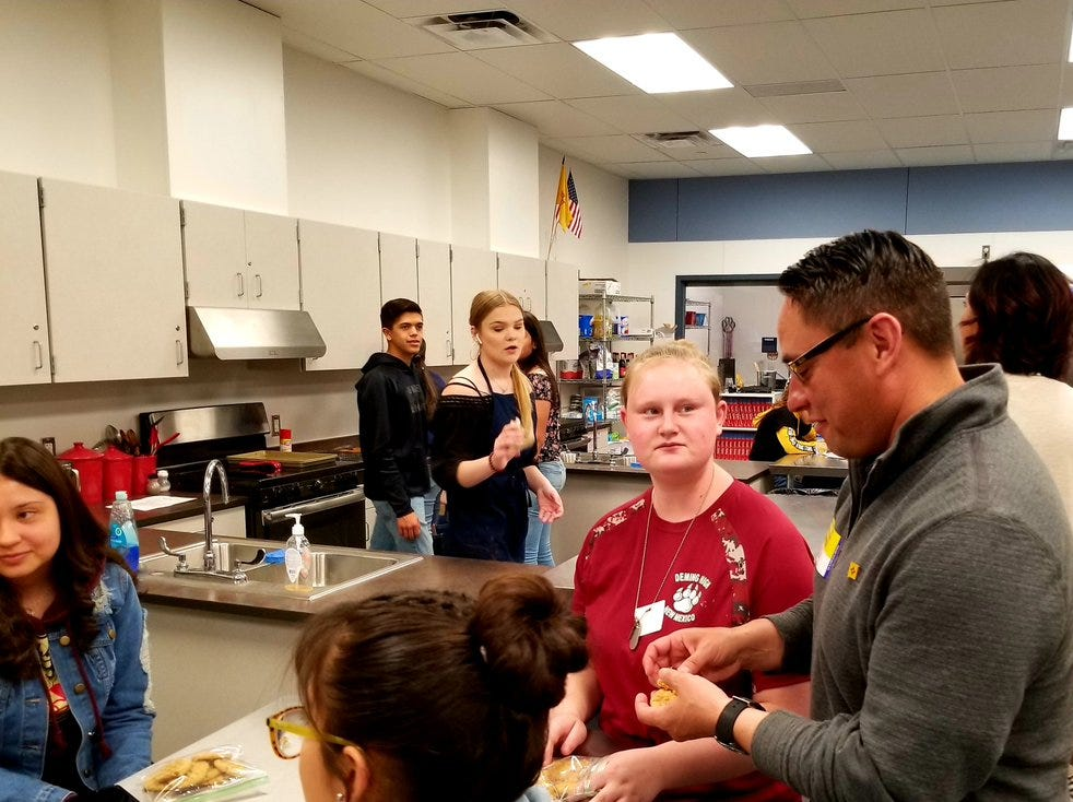 Deming High Sophomore Makinzie Gray, 16, offered Lt. Gov. Howie Morales a peanut butter cookie when he visited her culinary class on Thursday.