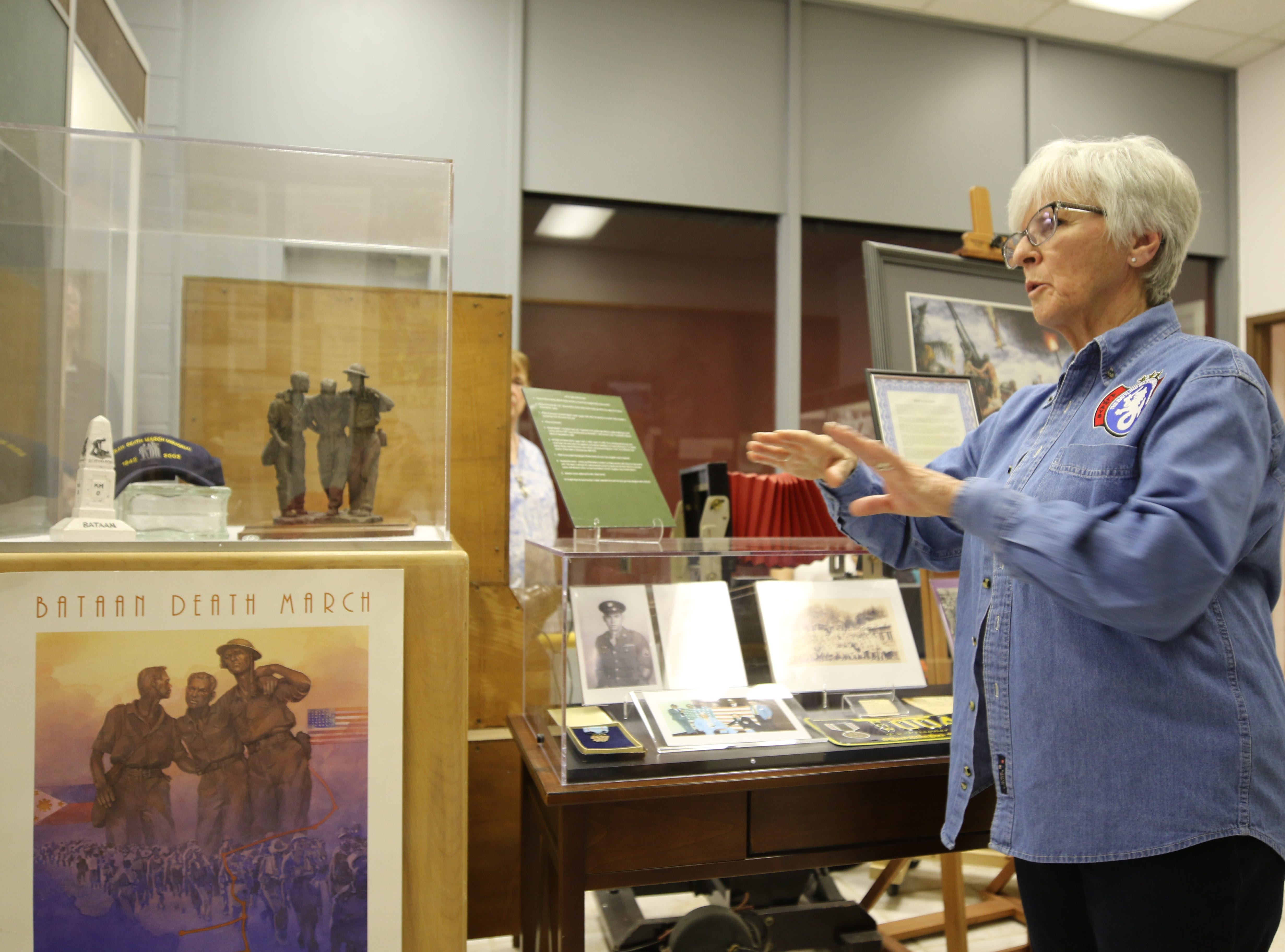 Joanna Sieberg talks about a Bataan Death March display April 9 at the Carlsbad Museum and Art Center. A dedication was held for her late father Charlie James, a Bataan Death March survivor. He received a U.S. Congressional Gold Medal, one of the highest civilian honors that can be bestowed to individuals.