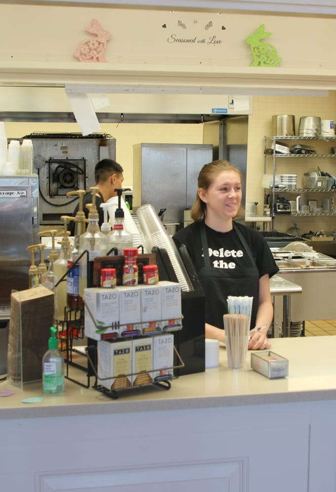 Stephanie Cassady gets ready to takes an order at PJ and B's Rio Cafe in Carlsbad.