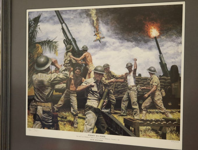 A painting depicting a key World War II battle in the Philippines on display at the Carlsbad Museum and Art Center.
