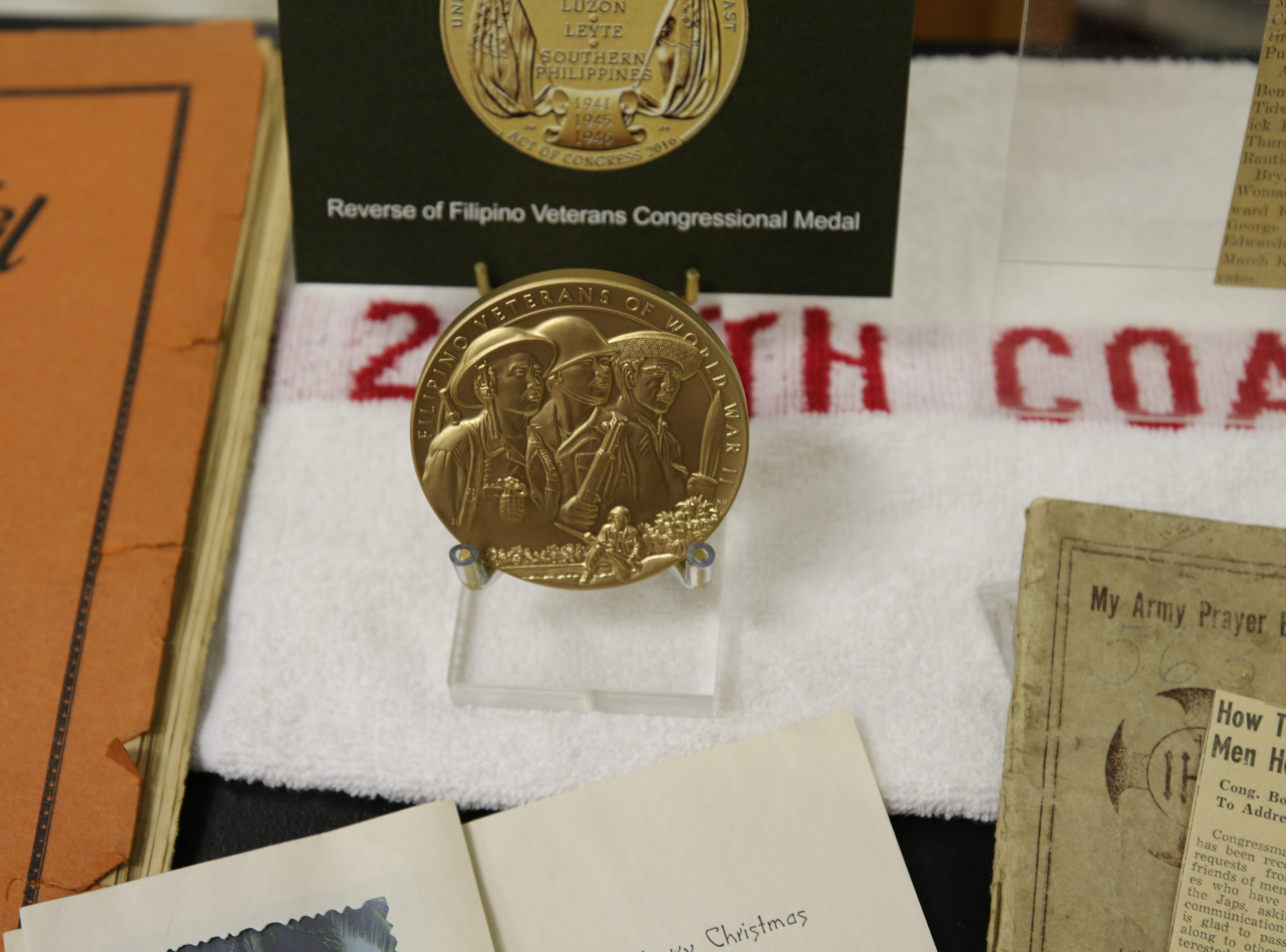 A replica of Charlie James' U.S. Congressional Gold Medal was on display April 9 at the Carlsbad Museum and Art Center. James' daughter Joanna Sieberg applied for the medal and received it on behalf of her late father, a Bataan Death March survivor.