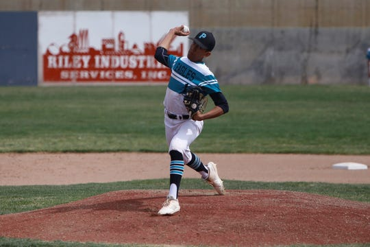 Navajo Prep's Marley Deschiney fires a pitch against Laguna Acoma on Thursday, April 4 at Farmington Sports Complex. Prep is ranked 10th in the latest 3A poll.