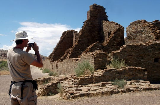 In this 2005, file photo, tourist Chris Farthing from Suffolks County, England, takes a picture while visiting Chaco Culture National Historical Park in northwestern New Mexico. Members of New Mexico's congressional delegation are renewing a call for the creation of a formal buffer around the national park, which is held sacred by Native Americans.