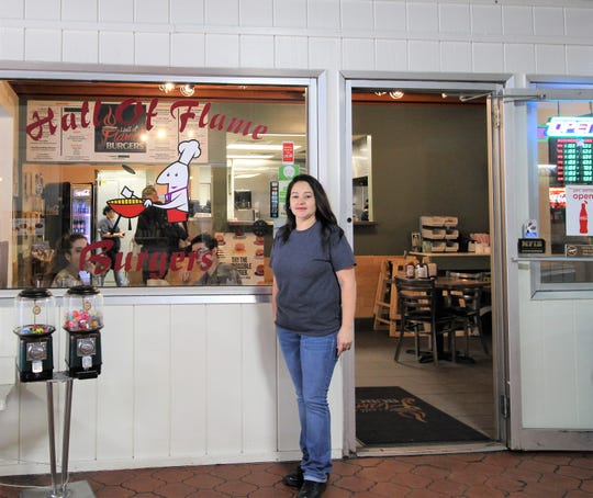 Cyndi Espinoza stands in front of the restaurant that her and her husband, Luiz, owns on the day she present $2,220 to the Warrior Pride Booster Club. The money was raised from a month long raffle at the restaurant\nt.