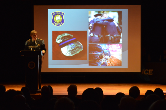 Livonia Police Chief Curtis Caid speaks at the April 2, 2019, Merit Award Ceremony at the Livonia Civic Center Library Auditorium.