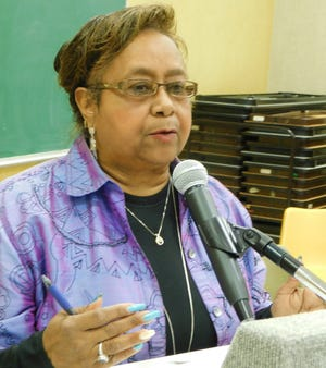 Lena Charles addresses the St. Landry Parish School Board on Monday about selling South Street campus property.
