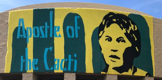 "This mural, made of more than 250,000 stitches of yarn, pays tribute to Minerva Hamilton Hoyt whose activism led the federal government to designate more than 800,000 acres of California desert as Joshua Tree National Monument in 1936. The mural, part of the ""Love Across the USA"" project, hangs on the south side of Palm Desert City Hall."