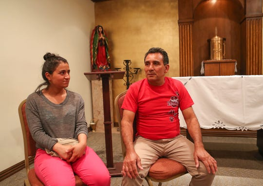 Asylum seekers from Guatemala Erika Villatoro, left, and Alexo Cardenas talk about why they came to the United States.  The two are with a group of refugees who are staying temporarily at Our Lady of Soledad Church in Coachella, April 8, 2019.