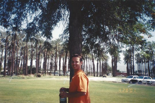 Dustin McCullum is photographed near his house across the street from the Empire Polo Club in 2001. Those palm trees are no longer there.