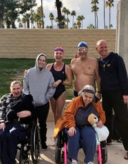 Swimmers Wanda Bogin, Michael Menduno and Steve Erickson with three Angel View clients before a fundraising swim on New Year's Eve Day at the Palm Springs Swim Center.