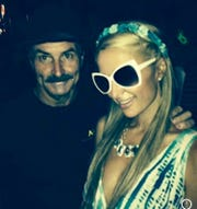 """Party producer Brian """"BB"""" Ingle poses with Paris Hilton after dancing with her in the Sahara tent at an early Coachella."""
