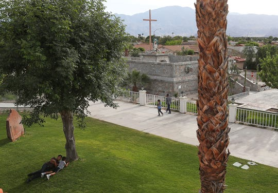 Asylum seekers from Guatemala pass the time on the campus of Our Lady of Soledad Church in Coachella, April 8, 2019.