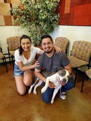 Jesus Lopez and Valeria Delgado pose with their dog, Trina. Trina was missing for a year.