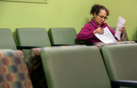 Teresa Nava, 51, looks over paperwork at the AltaMed office while waiting to see her doctor in Huntington Beach on Wednesday, February 6, 2019. (Photo by Mindy Schauer, Orange County Register/SCNG)