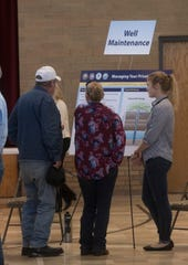 Property owners and residents living near Saufley Field attend an informational meeting Tuesday to learn more about the ongoing well water testing and possible groundwater contamination issues in the area.