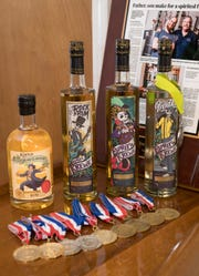 Paul and Patrick Rollins show off some of their award-winning spirits on Tuesday, April 9, 2019. The Gulf Breeze father and son duo have won a variety of medals for their rum and vodka.