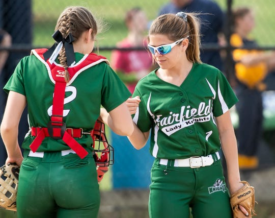 Fairfield starting pitcher Haylee Wastler, right, fist bumps with her sister and catcher, Braidan Wastler, before the start of an inning in a YAIAA regular-season softball game against Littlestown on Tuesday, April 9, 2019. The Lady Knights won 9-5.