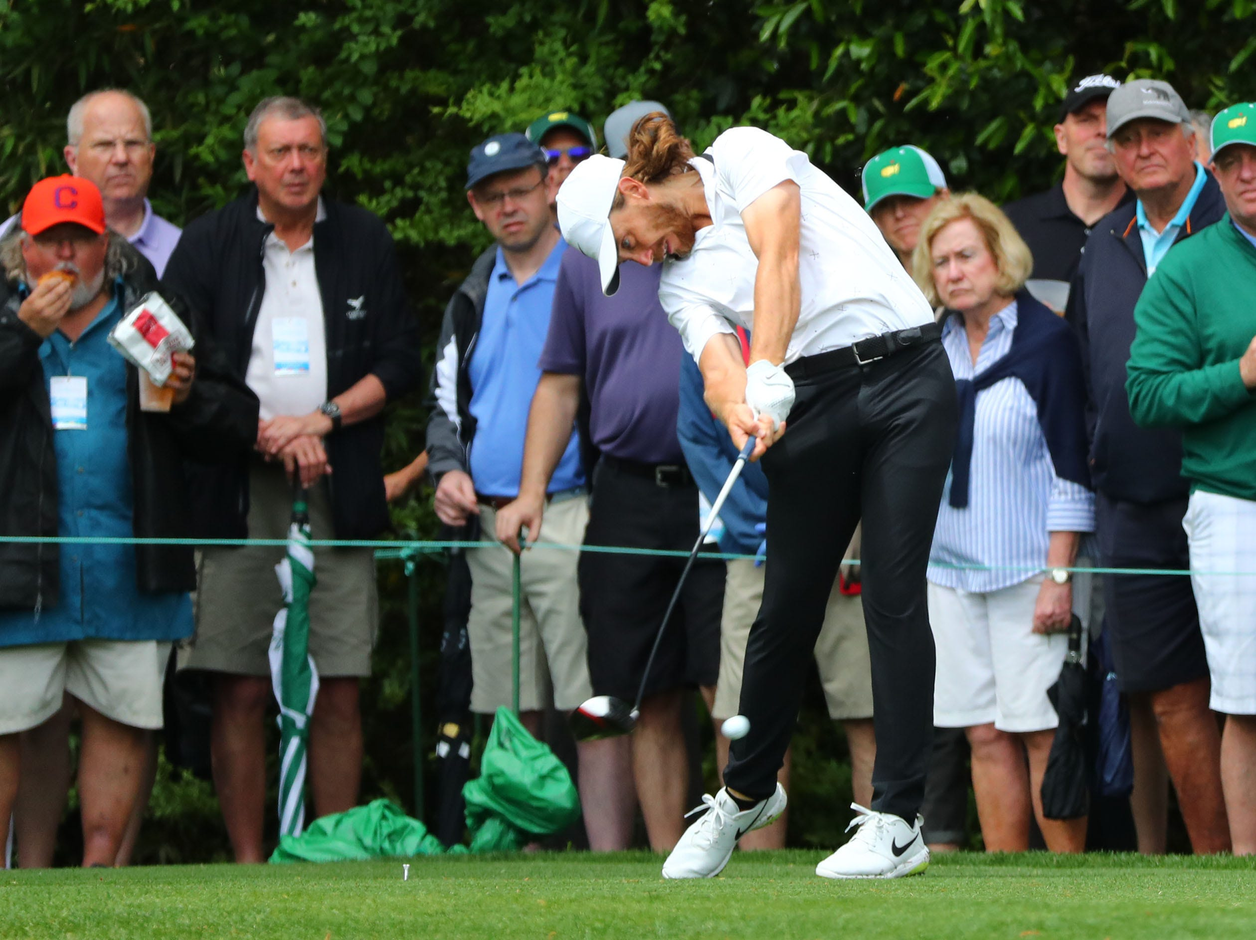 Apr 9, 2019; Augusta, GA, USA; Tommy Fleetwood of England plays his drive on the 14th hole during a practice round for The Masters golf tournament at Augusta National Golf Club. Mandatory Credit: Rob Schumacher-USA TODAY Sports