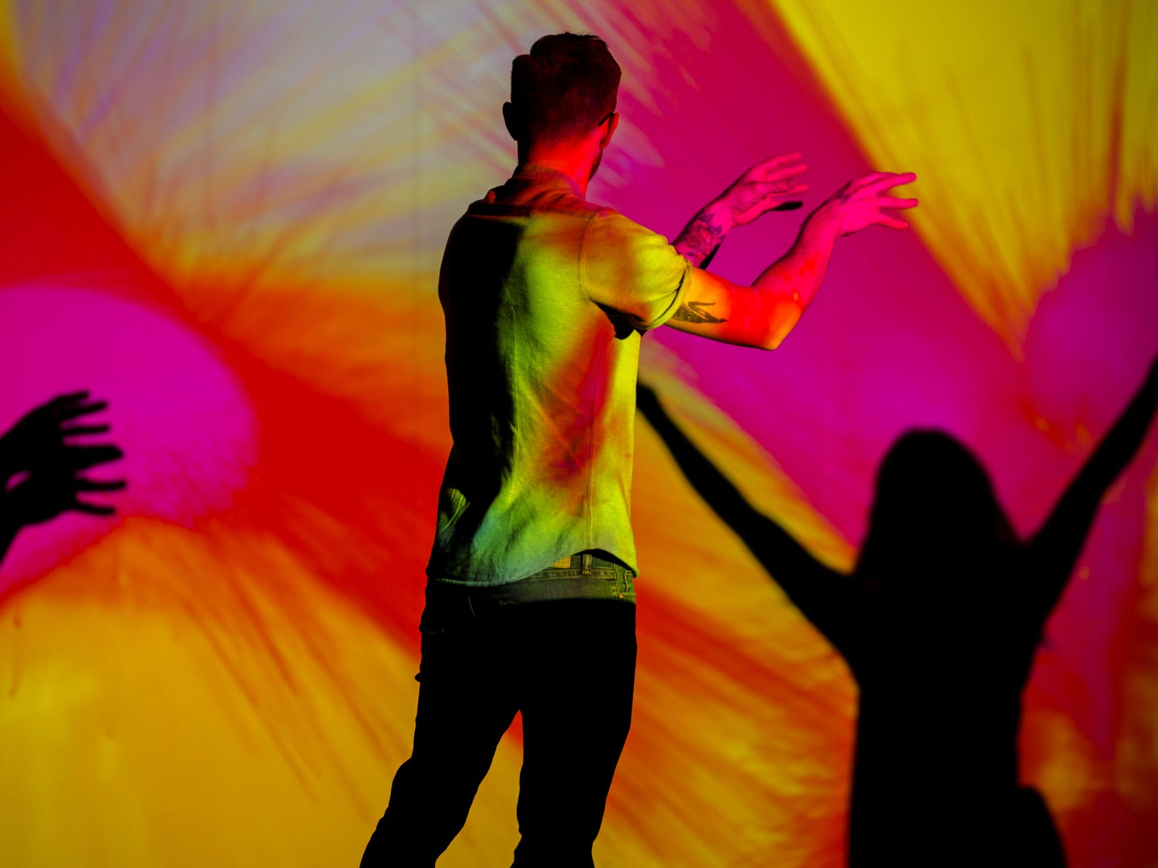 """""""Body Paint"""" by Memo Akten is a visual instrument that allows visitors to paint on a virtual canvas with their body. The artwork is part of Wonderspaces Arizona, an immersive art show open April through mid-July 2019 at Scottsdale Fashion Square."""