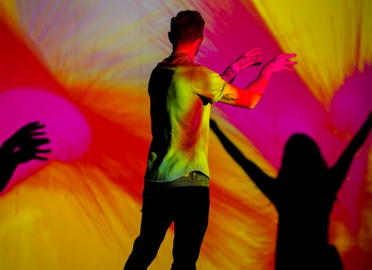"""Body Paint"" by Memo Akten is a visual instrument that allows visitors to paint on a virtual canvas with their body."