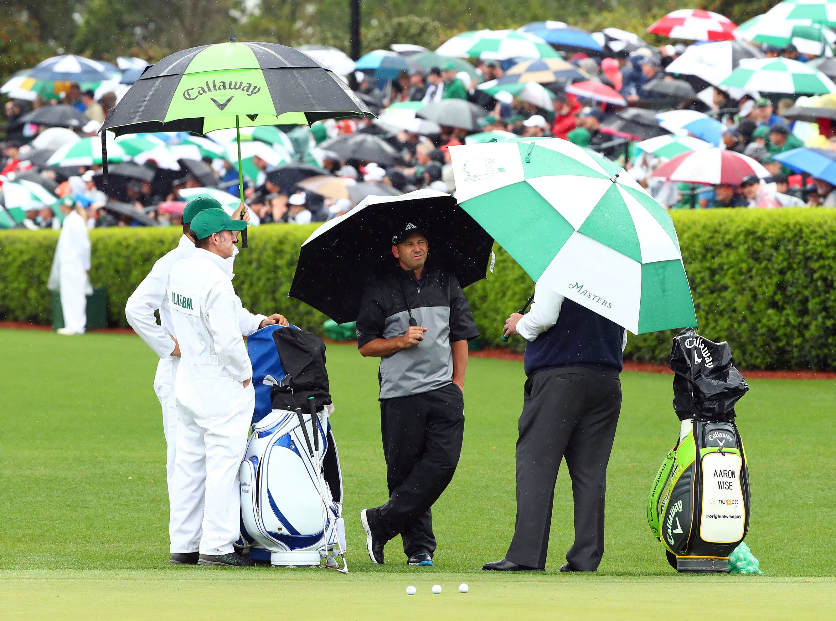 Apr 9, 2019; Augusta, GA, USA; Sergio Garcia of Spain talks with John Paramor, the European Tour's chief rules official (right) at the practice facility during a practice round for The Masters golf tournament at Augusta National Golf Club. Mandatory Credit: Rob Schumacher-USA TODAY Sports