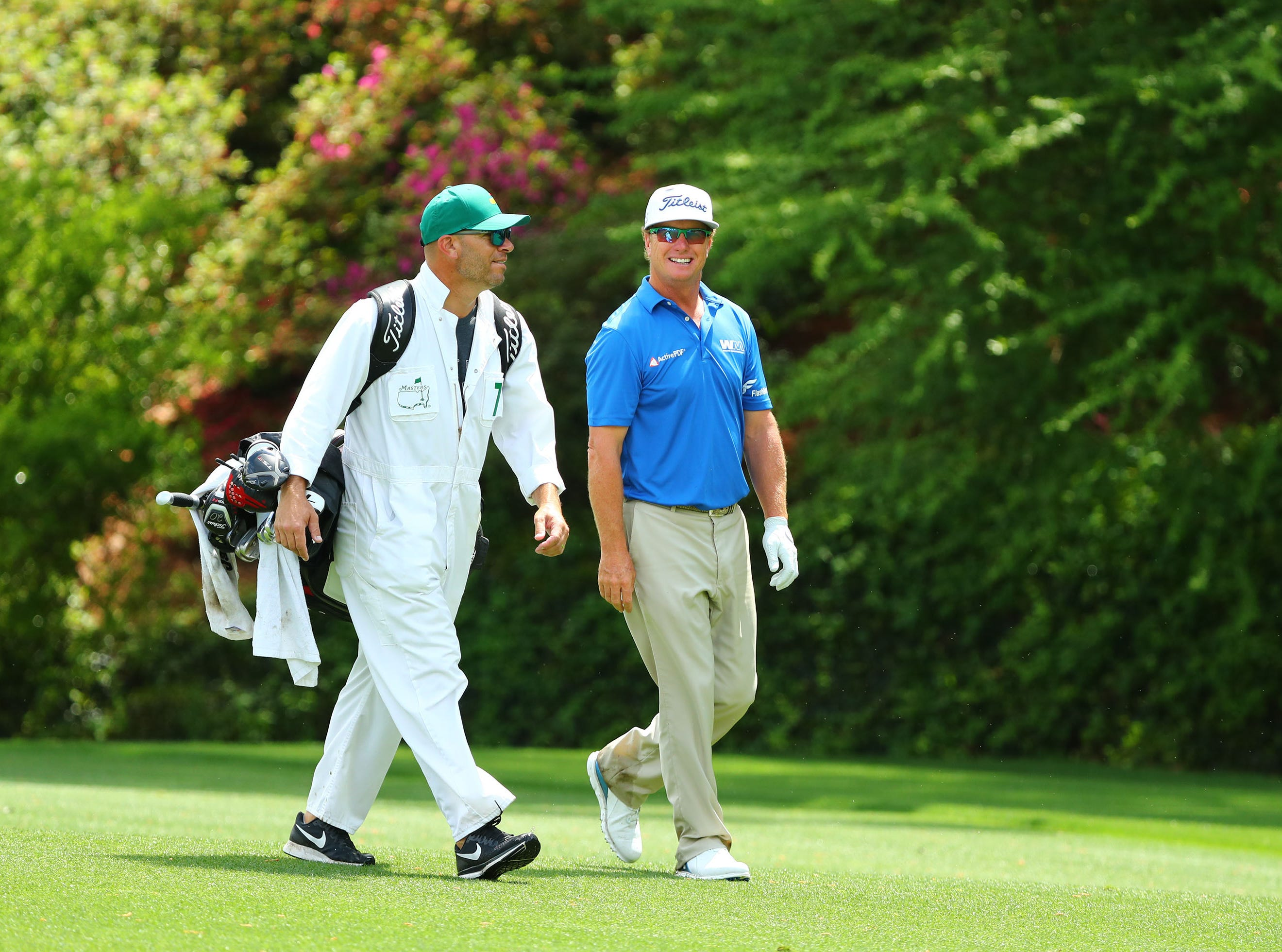 Apr 9, 2019; Augusta, GA, USA; Charley Hoffman and caddie Andy Barnes walk down the 13th fairway during a practice round for The Masters golf tournament at Augusta National Golf Club. Mandatory Credit: Rob Schumacher-USA TODAY Sports