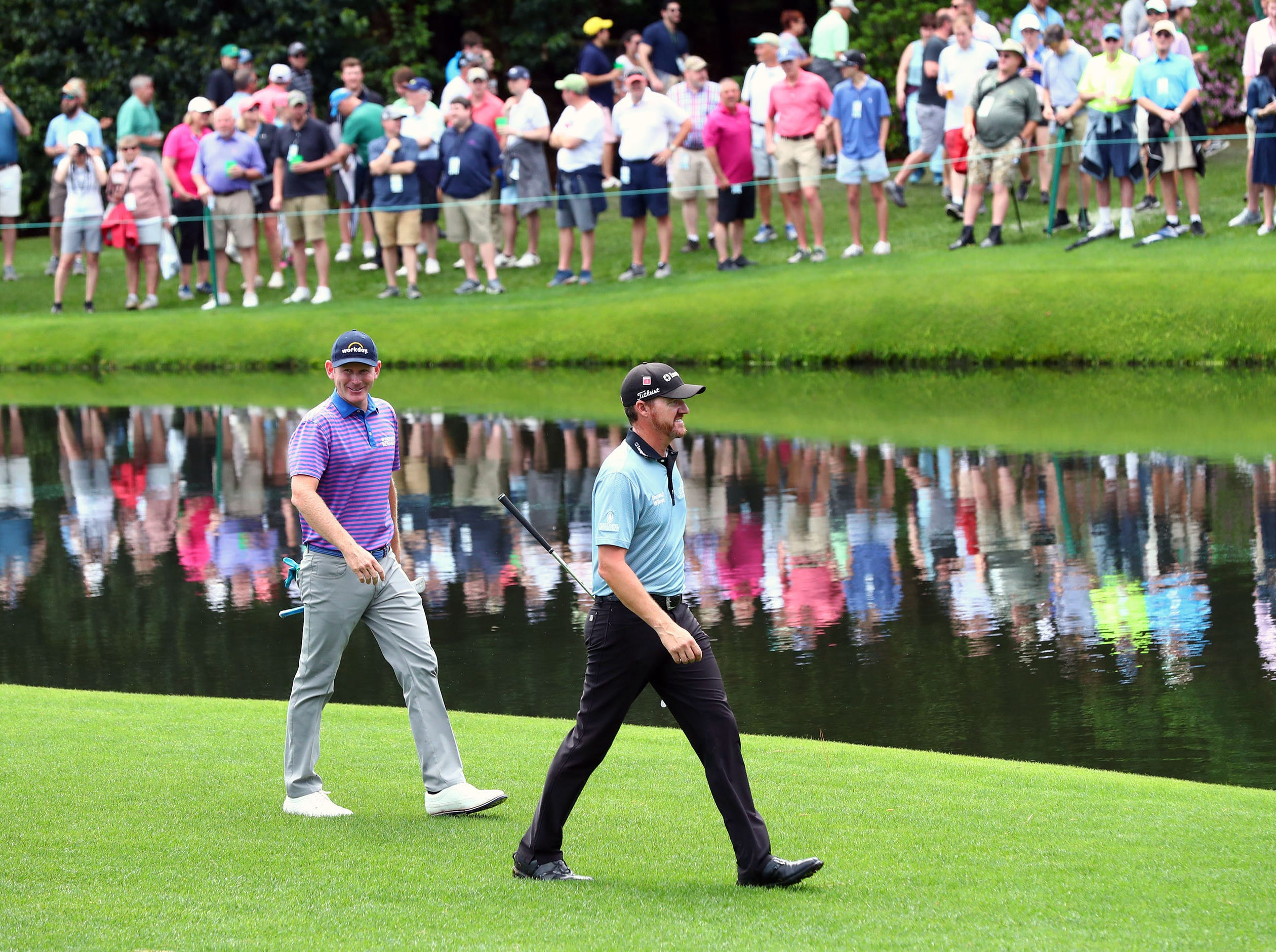 Apr 9, 2019; Augusta, GA, USA; Brandt Snedeker and Jimmy Walker walk to the green on the 16th hole during a practice round for The Masters golf tournament at Augusta National Golf Club. Mandatory Credit: Rob Schumacher-USA TODAY Sports