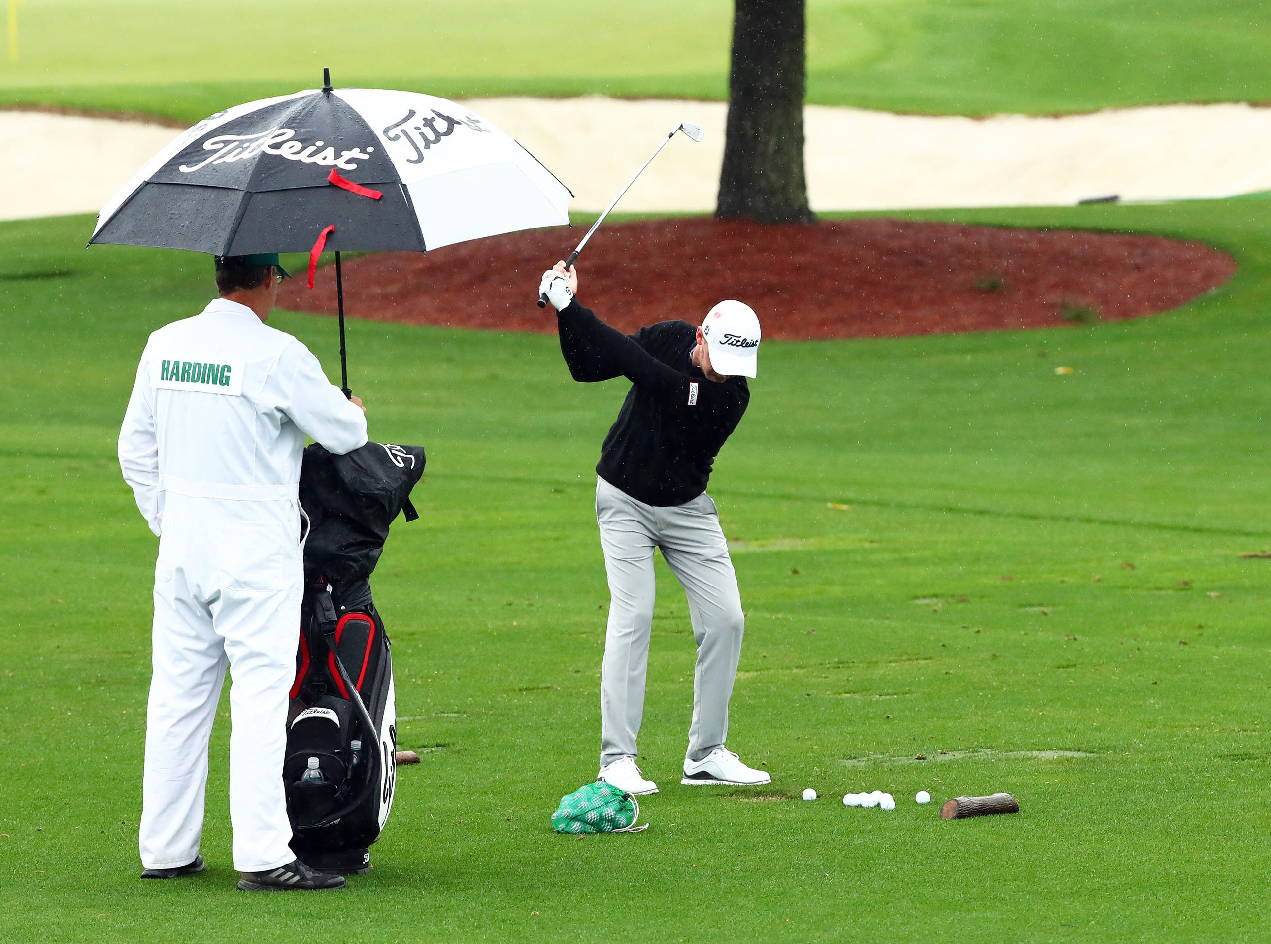 Apr 9, 2019; Augusta, GA, USA; Justin Harding of South Africa hits balls at the practice facility during a practice round for The Masters golf tournament at Augusta National Golf Club. Mandatory Credit: Rob Schumacher-USA TODAY Sports