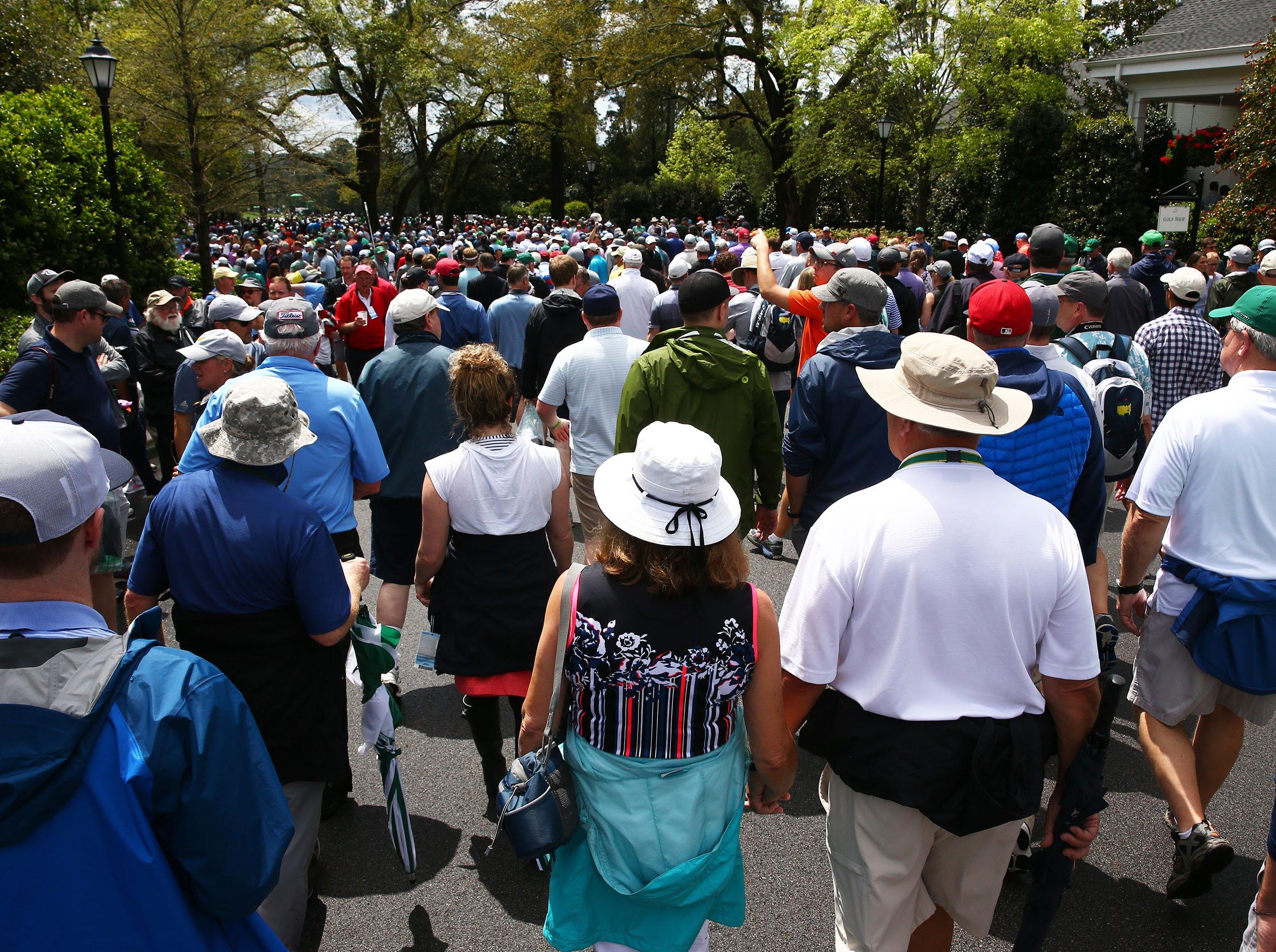 Apr 9, 2019; Augusta, GA, USA; Patrons return to the course after a weather delay during a practice round for The Masters golf tournament at Augusta National Golf Club. Mandatory Credit: Rob Schumacher-USA TODAY Sports
