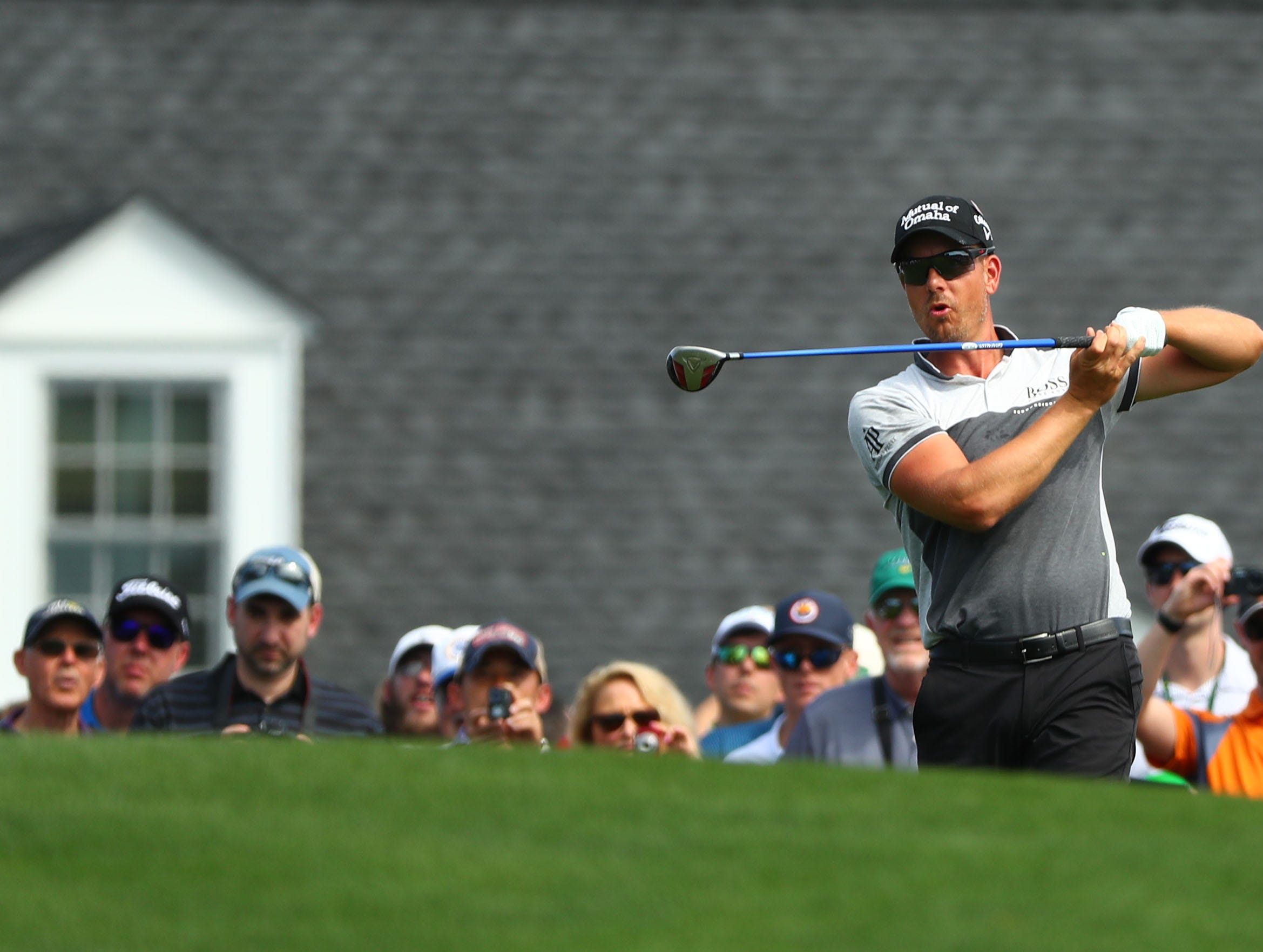 Apr 9, 2019; Augusta, GA, USA; Henrik Stenson of Sweden reacts after hitting his drive on the first hole during a practice round for The Masters golf tournament at Augusta National Golf Club. Mandatory Credit: Rob Schumacher-USA TODAY Sports