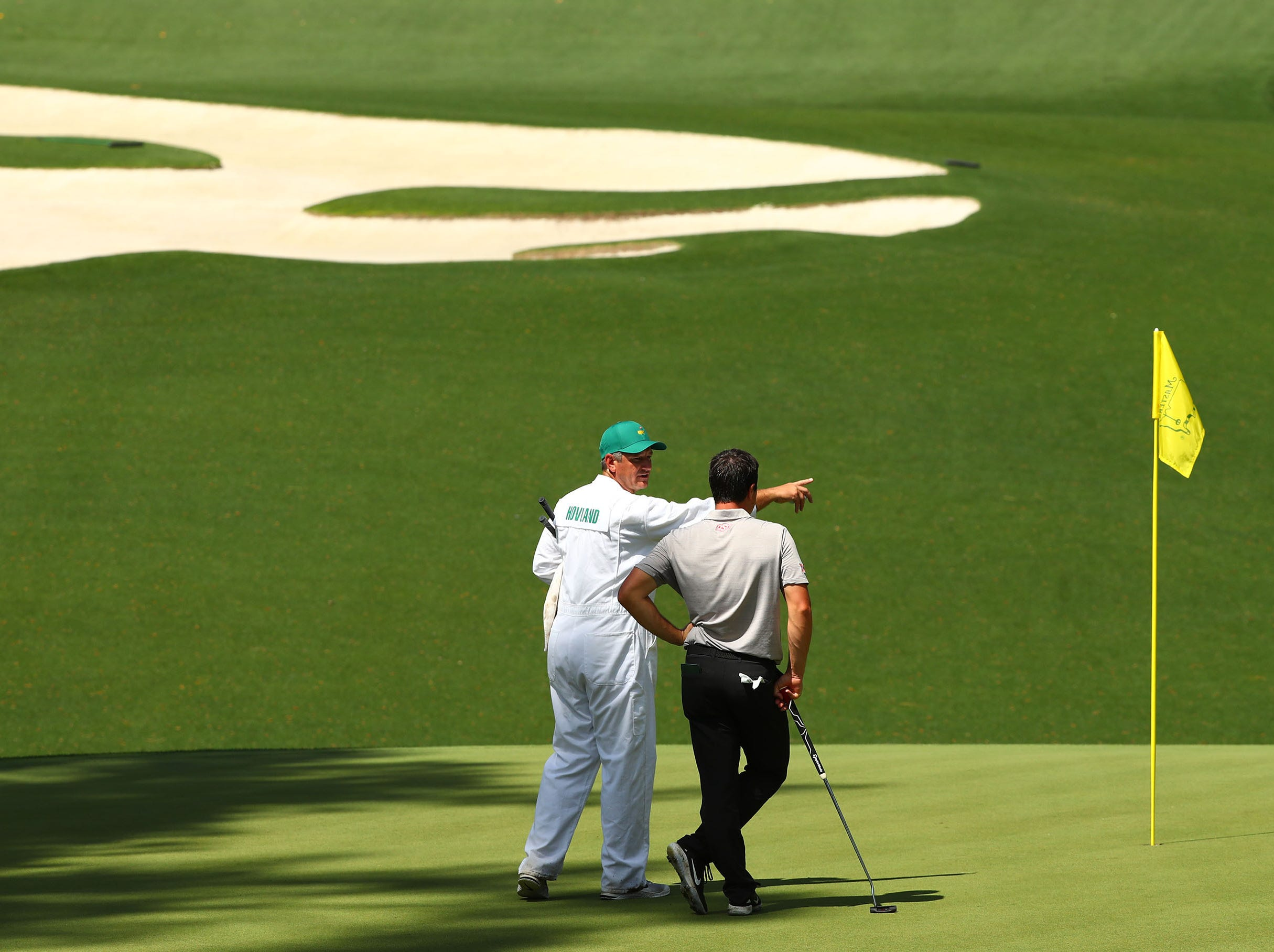 Apr 9, 2019; Augusta, GA, USA; Viktor Hovland and caddie Alan Bratton survey the 10th hole during a practice round for The Masters golf tournament at Augusta National Golf Club. Mandatory Credit: Rob Schumacher-USA TODAY Sports