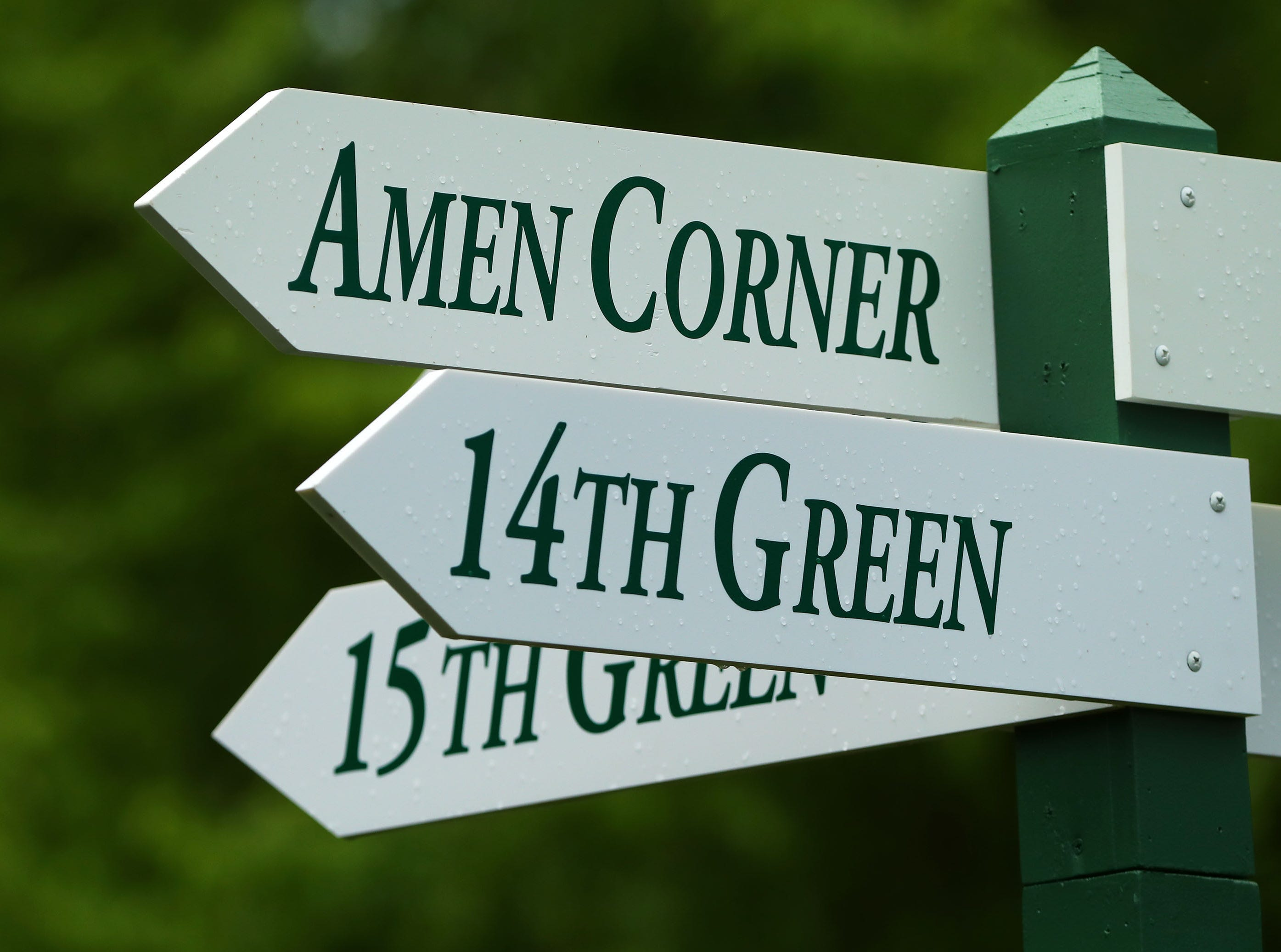 Apr 9, 2019; Augusta, GA, USA; Amen Corner sign near the 16th green during a practice round for The Masters golf tournament at Augusta National Golf Club. Mandatory Credit: Rob Schumacher-USA TODAY Sports