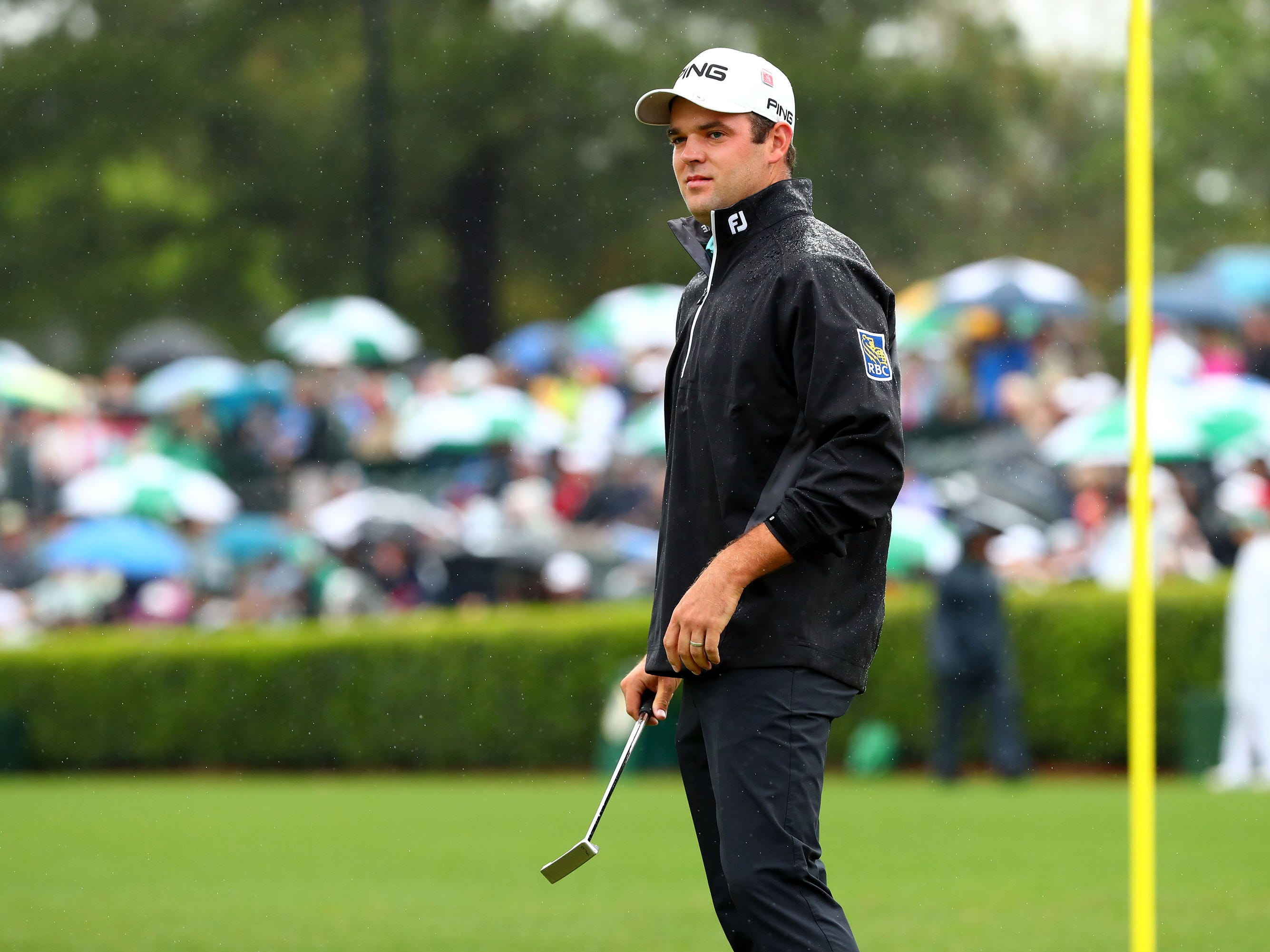 Apr 9, 2019; Augusta, GA, USA; Corey Conners putts at the practice facility during a practice round for The Masters golf tournament at Augusta National Golf Club. Mandatory Credit: Rob Schumacher-USA TODAY Sports