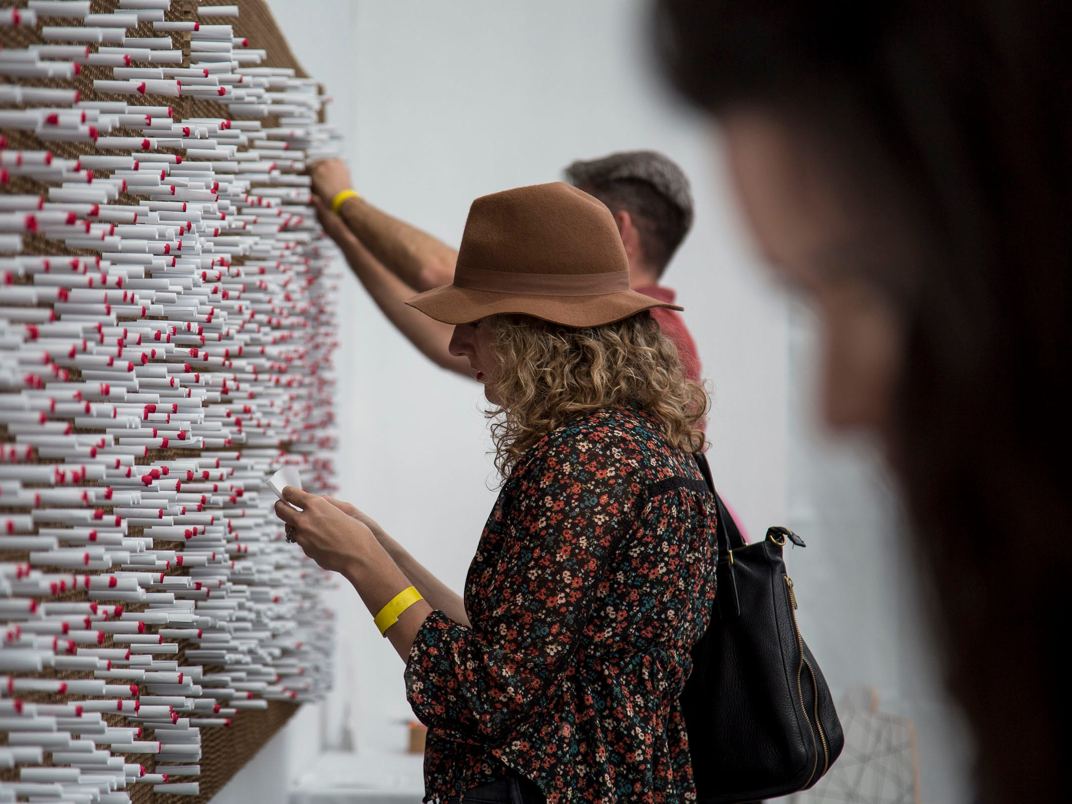 """""""The Last Word"""" by Illegal Art features hundreds of tightly rolled pieces of paper where participants can read and write things that have never been said at Wonderspaces Arizona at the Scottsdale Fashion Square."""