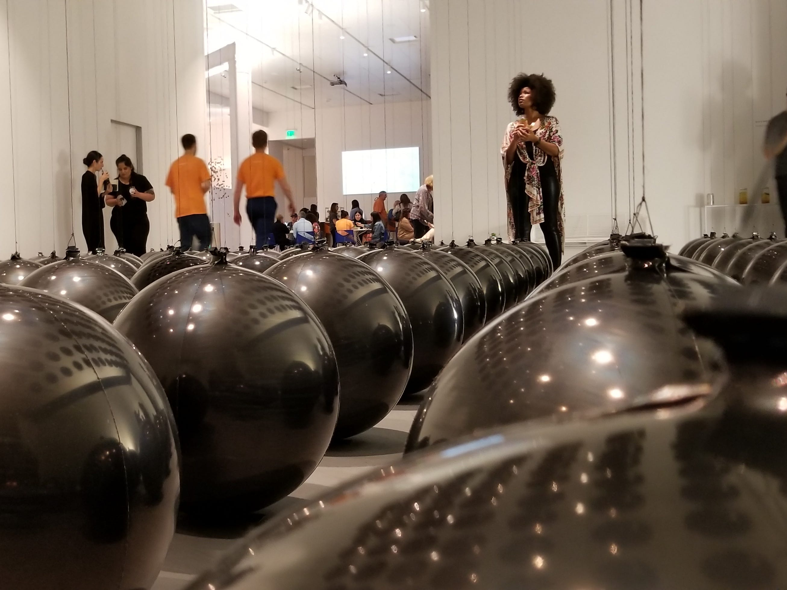 """""""Black Balloons"""" by Tadao Cern is comprised of balloons with opposing weights. The artwork is part of Wonderspaces Arizona, an immersive art show open April through mid-July 2019 at Scottsdale Fashion Square."""