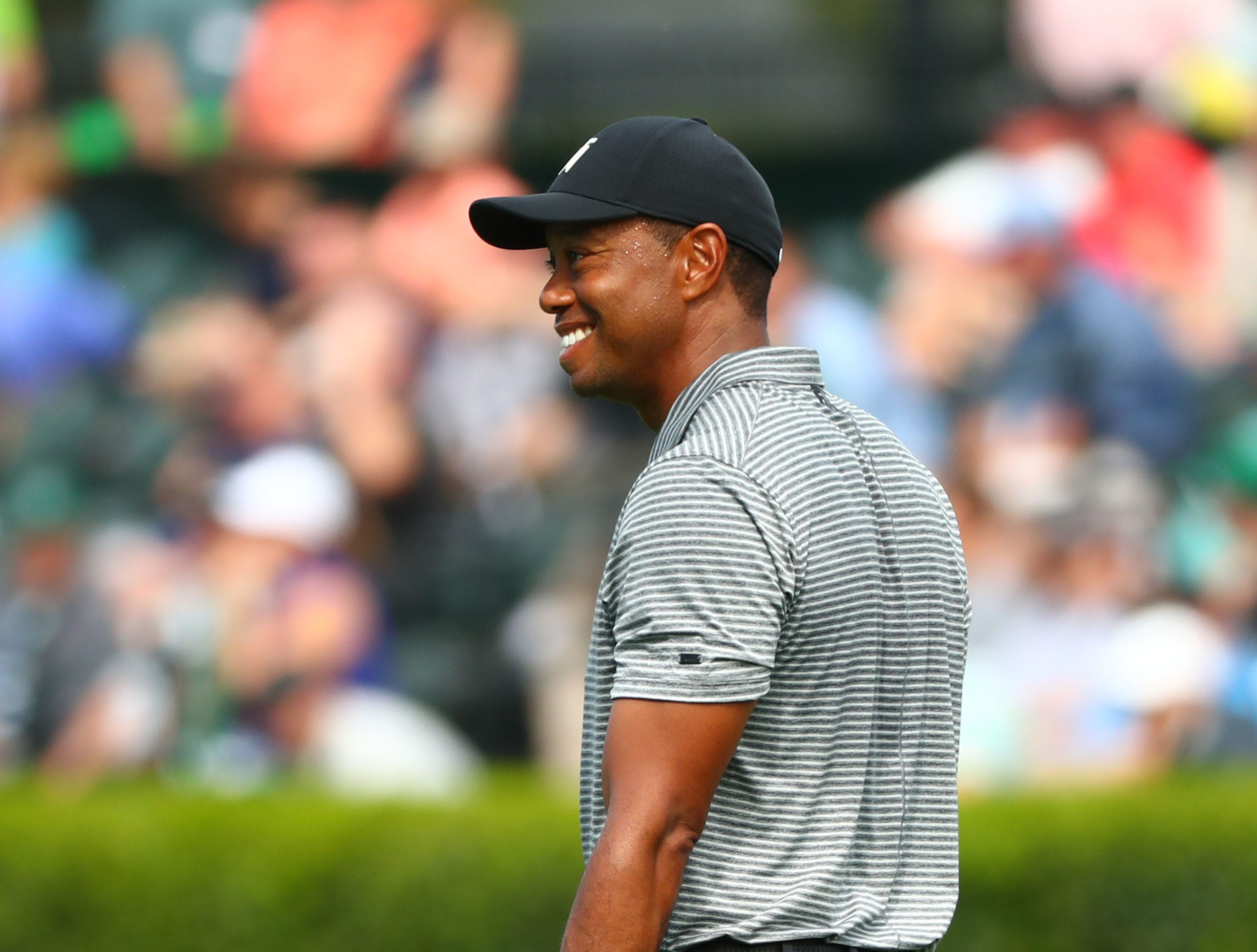 Apr 9, 2019; Augusta, GA, USA; Tiger Woods leaves the practice facility during a practice round for The Masters golf tournament at Augusta National Golf Club. Mandatory Credit: Rob Schumacher-USA TODAY Sports