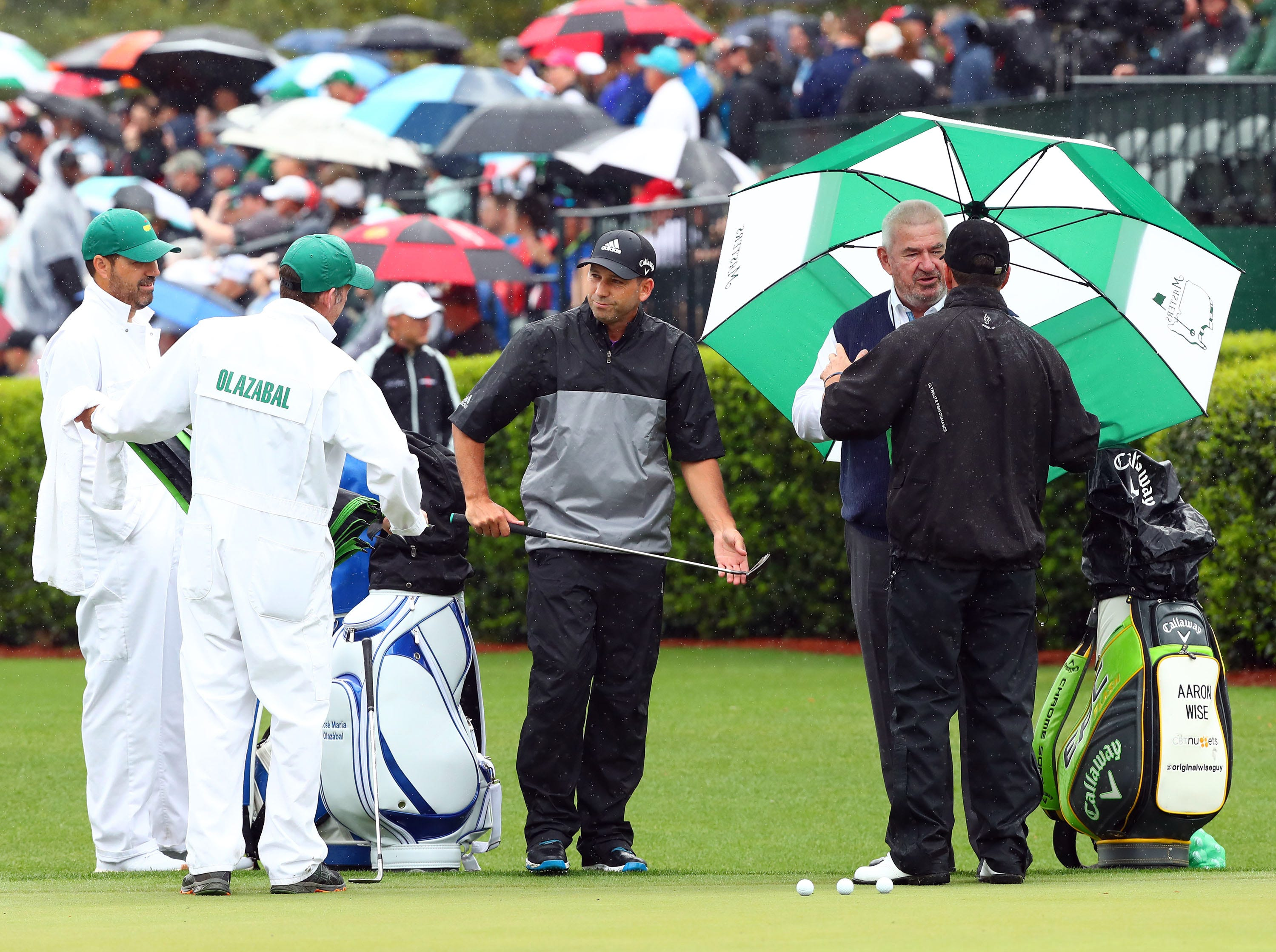 Apr 9, 2019; Augusta, GA, USA; Masters champions Sergio Garcia of Spain and Jose Maria Olazabal of Spain talks with John Paramor, the European Tour's chief rules official at the practice facility during a practice round for The Masters golf tournament at Augusta National Golf Club. Mandatory Credit: Rob Schumacher-USA TODAY Sports
