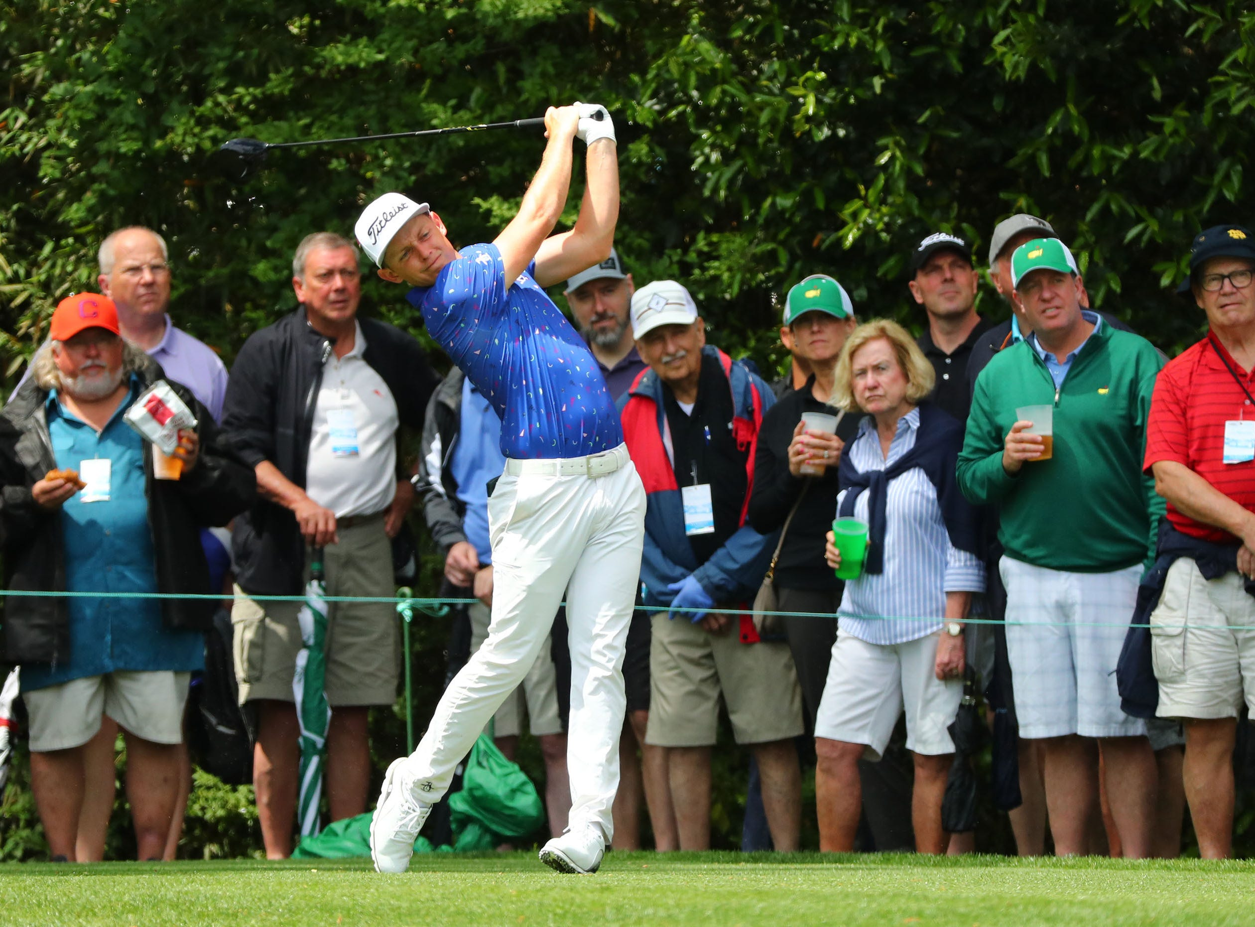 Apr 9, 2019; Augusta, GA, USA; Cameron Smith of Australia hits his drive on the 14th hole during a practice round for The Masters golf tournament at Augusta National Golf Club. Mandatory Credit: Rob Schumacher-USA TODAY Sports