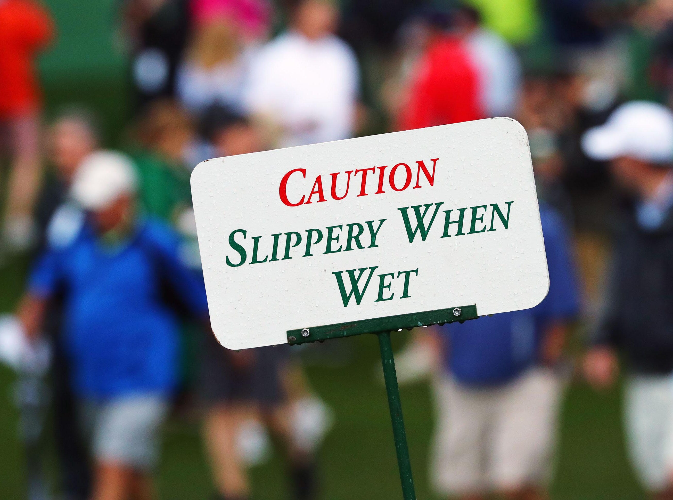 Apr 9, 2019; Augusta, GA, USA; Patrons take the course under a weather warning with rain and the threat of thunderstorms during a practice round for The Masters golf tournament at Augusta National Golf Club. Mandatory Credit: Rob Schumacher-USA TODAY Sports