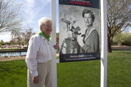 Marilynn Smith poses with a photo of herself from her younger days. Smith was one of the 13 founders of the LPGA.