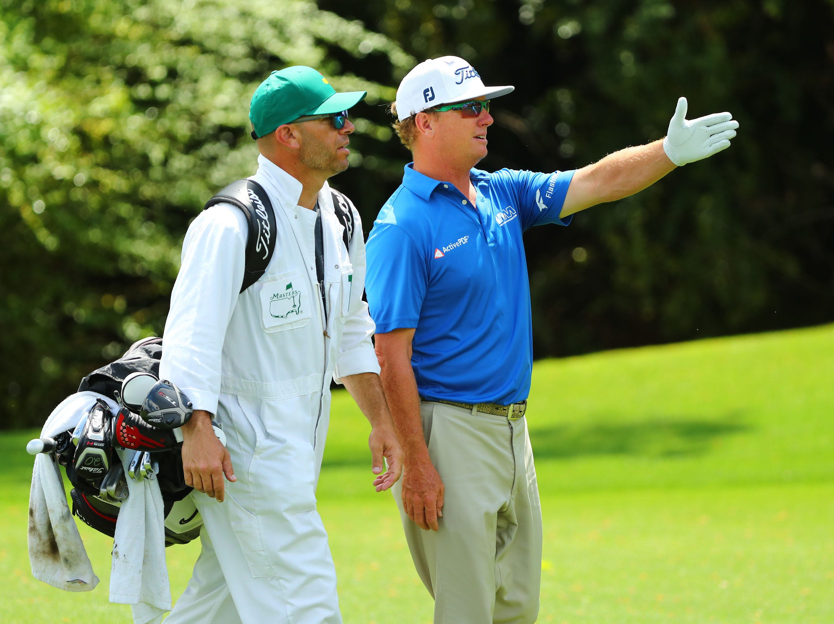 Apr 9, 2019; Augusta, GA, USA; Charley Hoffman and caddie Andy Barnes discuss a shot on the 13th fairway during a practice round for The Masters golf tournament at Augusta National Golf Club. Mandatory Credit: Rob Schumacher-USA TODAY Sports