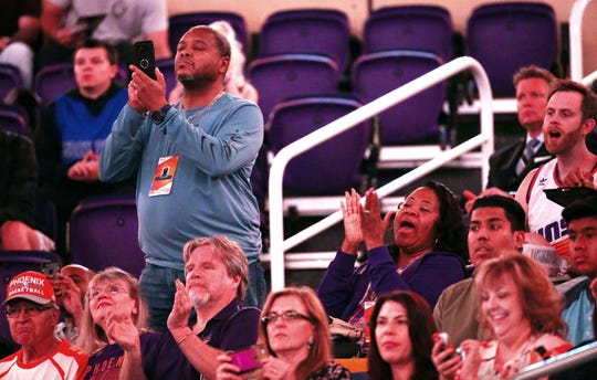 Dr. Richard and Dr. Lydecia Holmes watch their son, Suns forward Richaun Holmes, take the court during player introductions on April 3.
