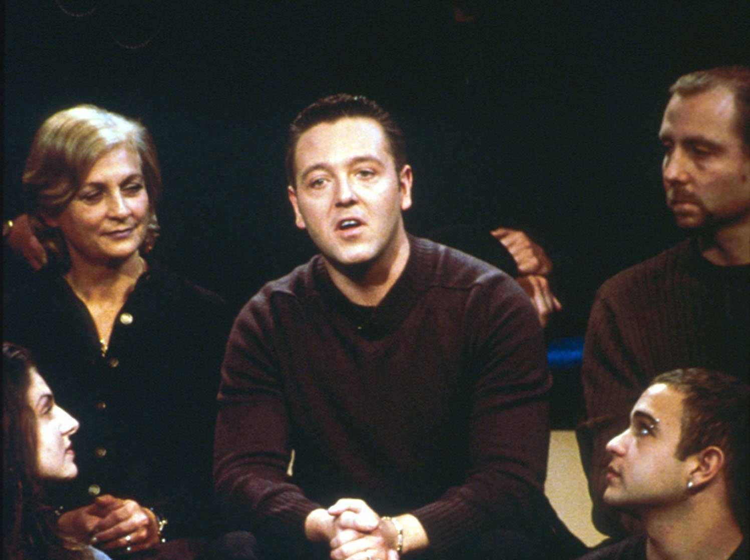 """John Edward talks to the audience of the """"Crossing Over with John Edward"""" show in 2001."""